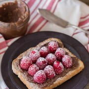 Chocolate Hazelnut Raspberry Toast - Homemade chocolate hazelnut spread on toast with fresh raspberries and powdered sugar.