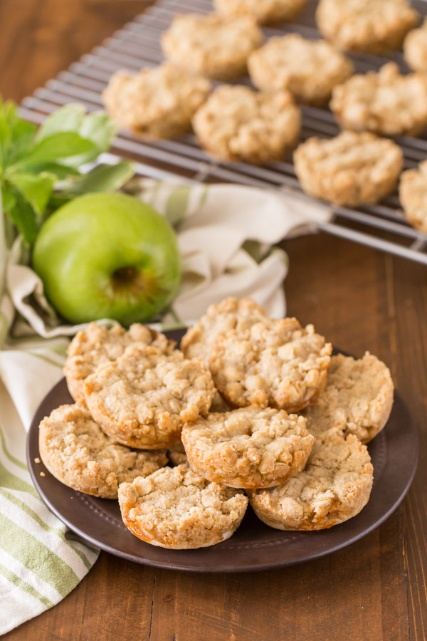Dutch Apple Pie Cookies arranged on a small plate, with more cookies on a cooling rack in the background.