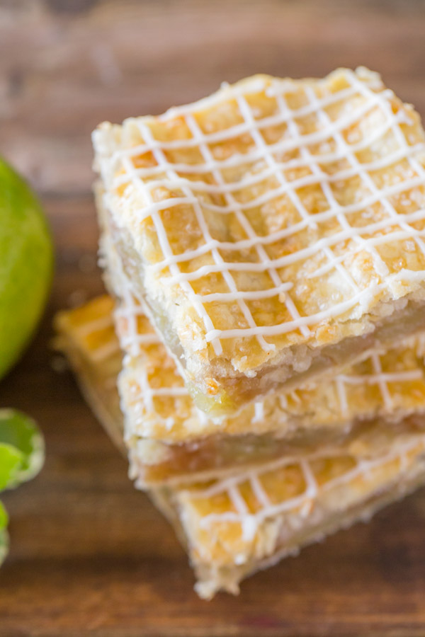 Three Iced Apple Pie Bars stacked on top of each other.