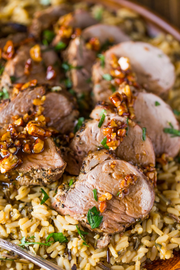 Pork Tenderloin sliced and served over rice and topped with a Sweet Chili Pecan Glaze.
