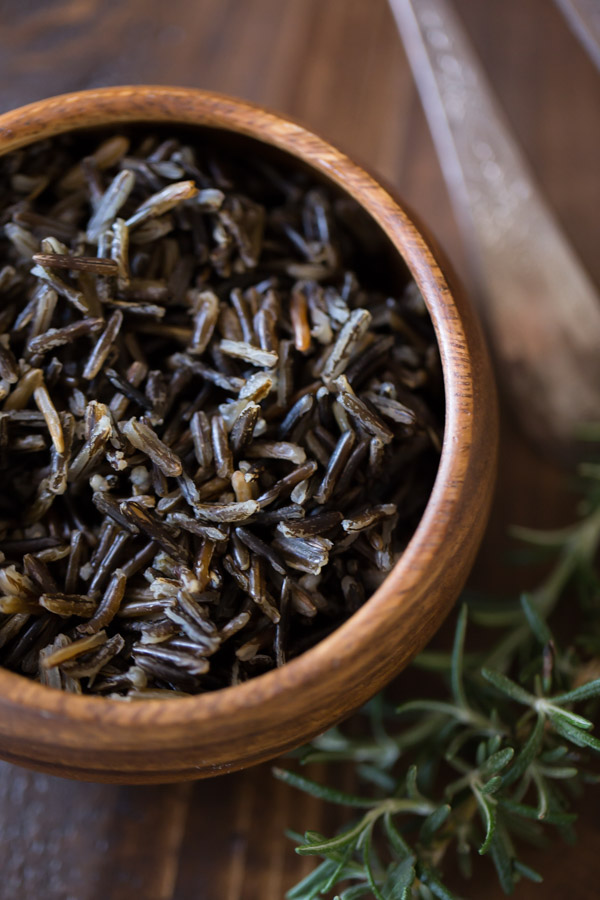 A small wood bowl of wild rice.