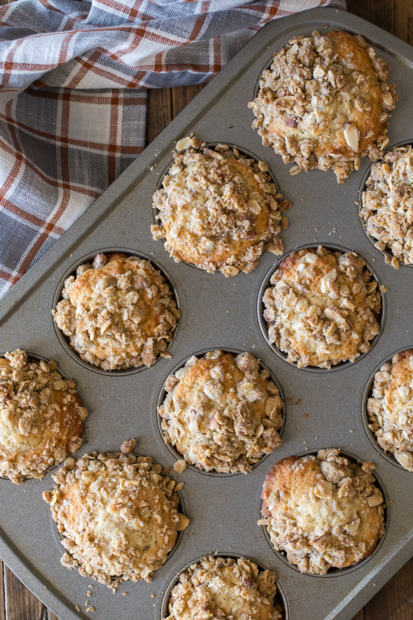 Banana Muffins With Almond Oat Streusel Topping in a muffin pan.