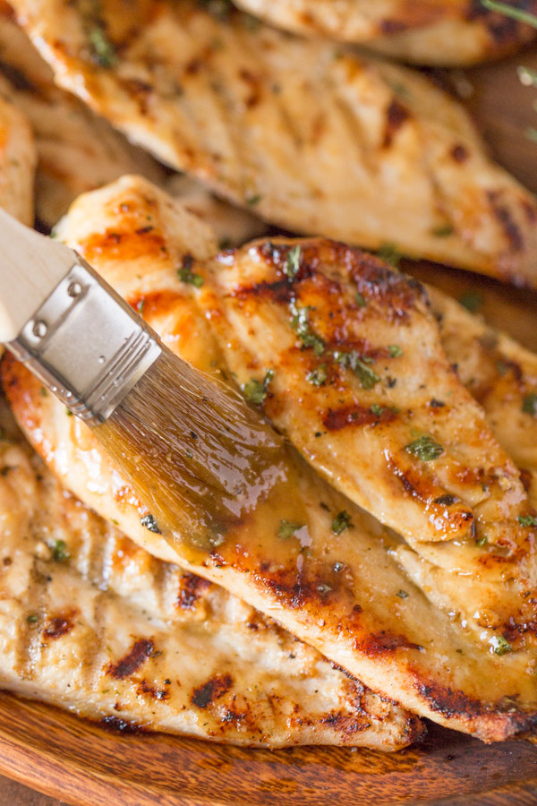 Honey Mustard Sauce being brushed onto the Grilled Chicken.