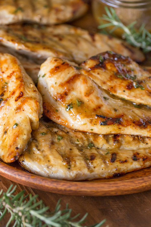 Honey Mustard Grilled Chicken breasts on a wood plate.
