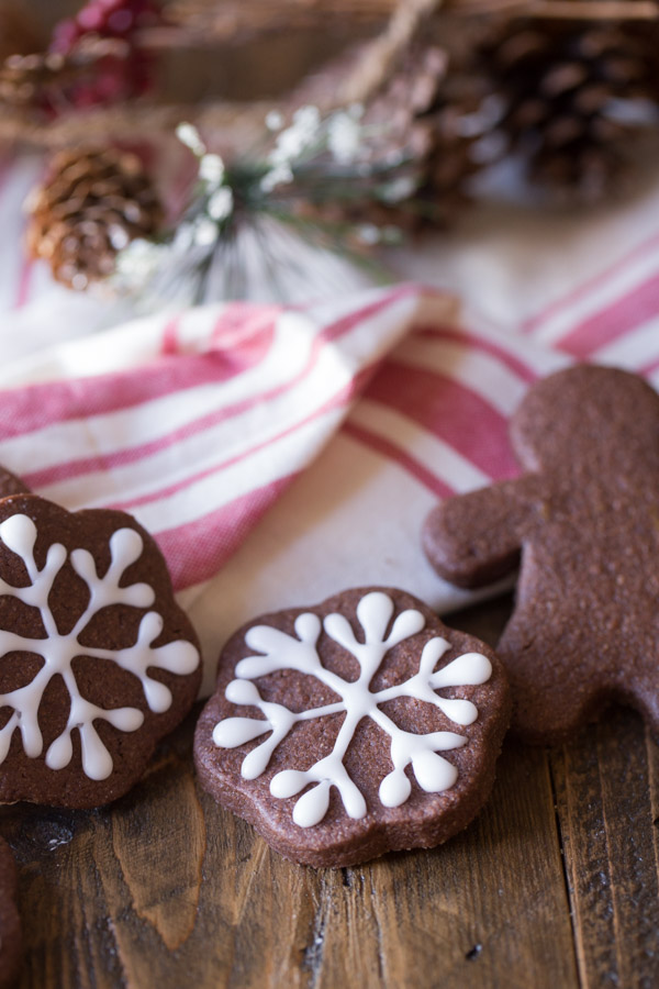 Snowflake Chocolate Cut-Out Cookies that have been decorated with icing, and a Gingerbread Man Chocolate Cut-Out Cookie.
