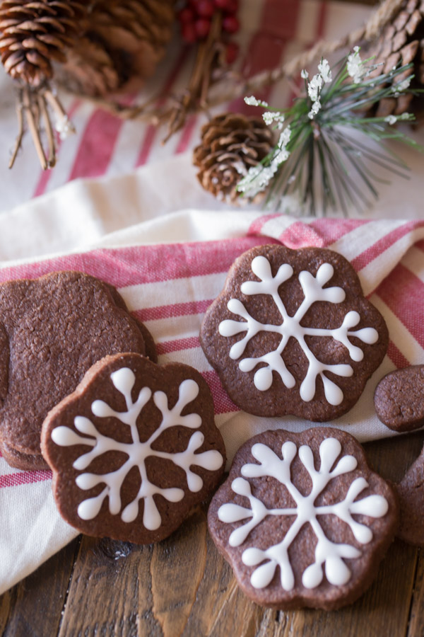 Snowflake Chocolate Cut-Out Cookies that have been decorated with icing.