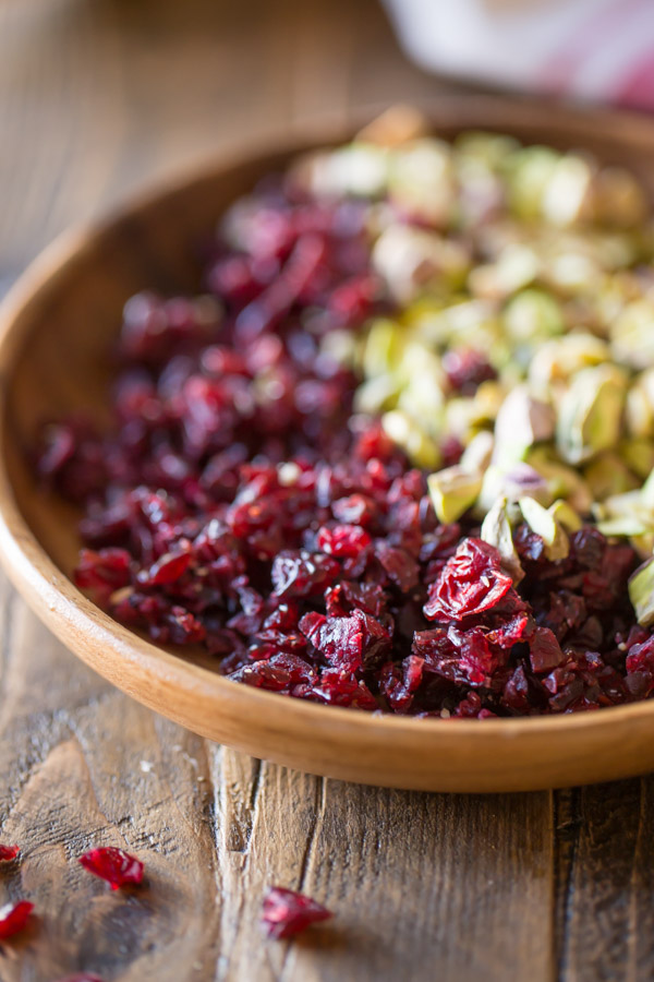 Chopped Cranberries and Pistachios in a wood bowl.