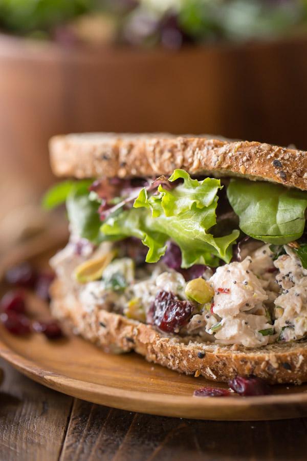 Cranberry Pistachio Chicken Salad Sandwich on a plate.