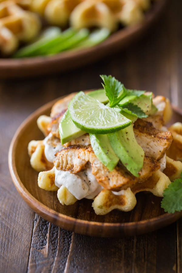 A Green Chile Chicken Waffletada assembled on a small wood plate.
