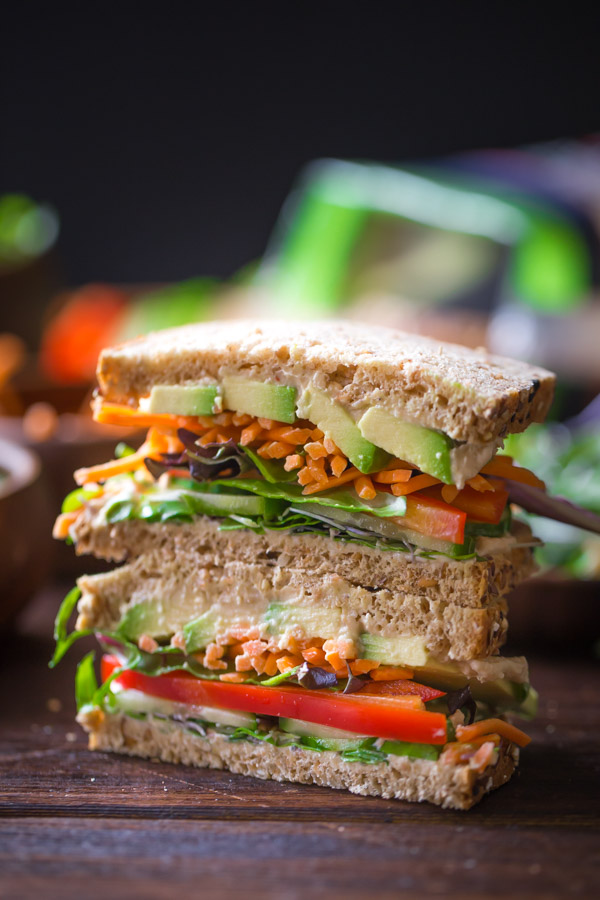 A Power Veggie Sandwich sliced in half and stacked on top of each other.