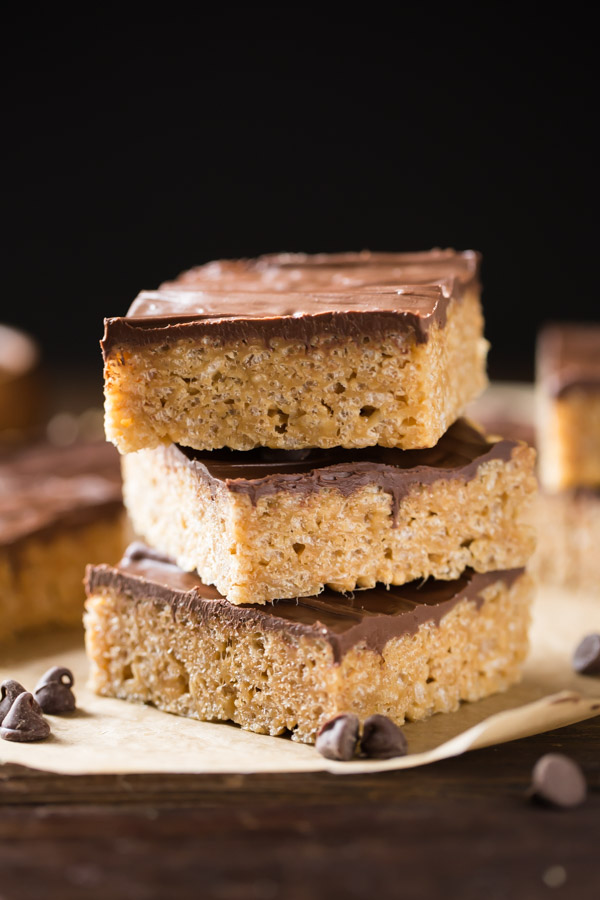 Three Chocolate Peanut Butter Rice Krispie Bars stacked on top of each other.