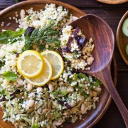 White Bean Couscous Salad With Lemon Vinaigrette - Baby greens, Israeli couscous, feta, dill, white beans, cucumber and pepitas make this salad light, fresh and healthy!