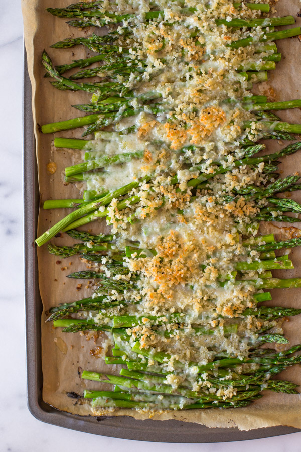 Roasted Asparagus With Panko and Gruyere on a parchment paper lined baking sheet.