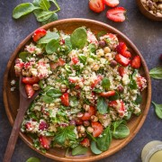 Strawberry Couscous Spinach Salad - A bright and cheery spring time salad with strawberries, couscous, spinach, feta, hazelnuts and an almond vinaigrette.