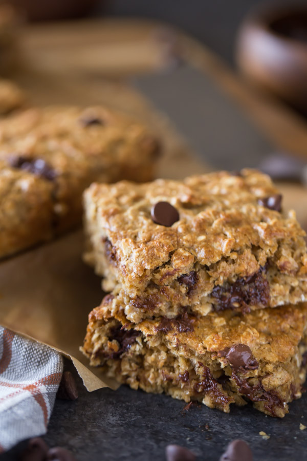 Two Whole Wheat Oatmeal Chocolate Chip Snack Bars stacked, with more bars in the background.