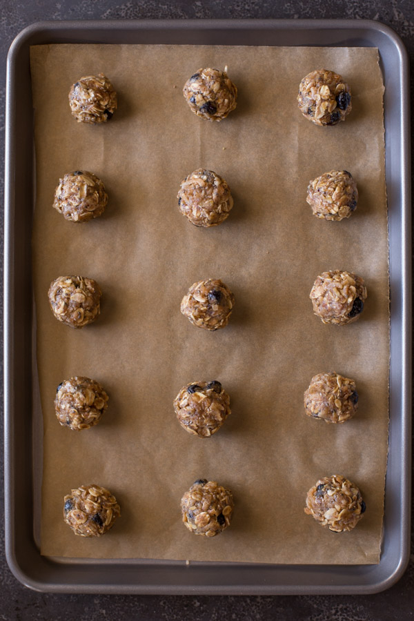 Blueberry Muffin Energy Bites on a parchment paper lined baking sheet.