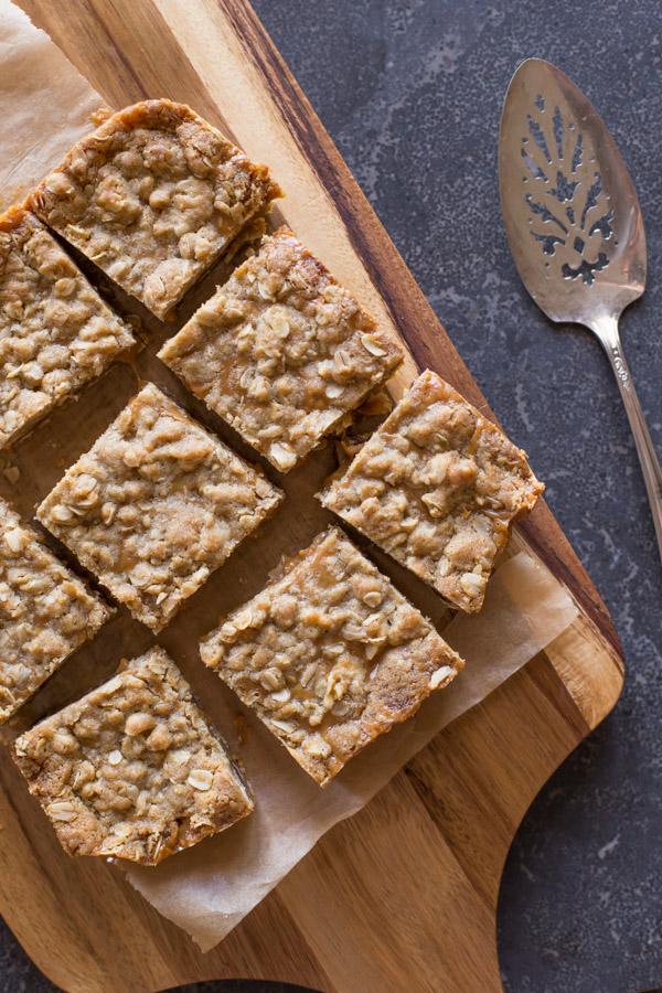 Carmelitas cut into squares on a cutting board.