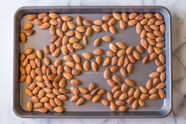 Almonds on a baking sheet.