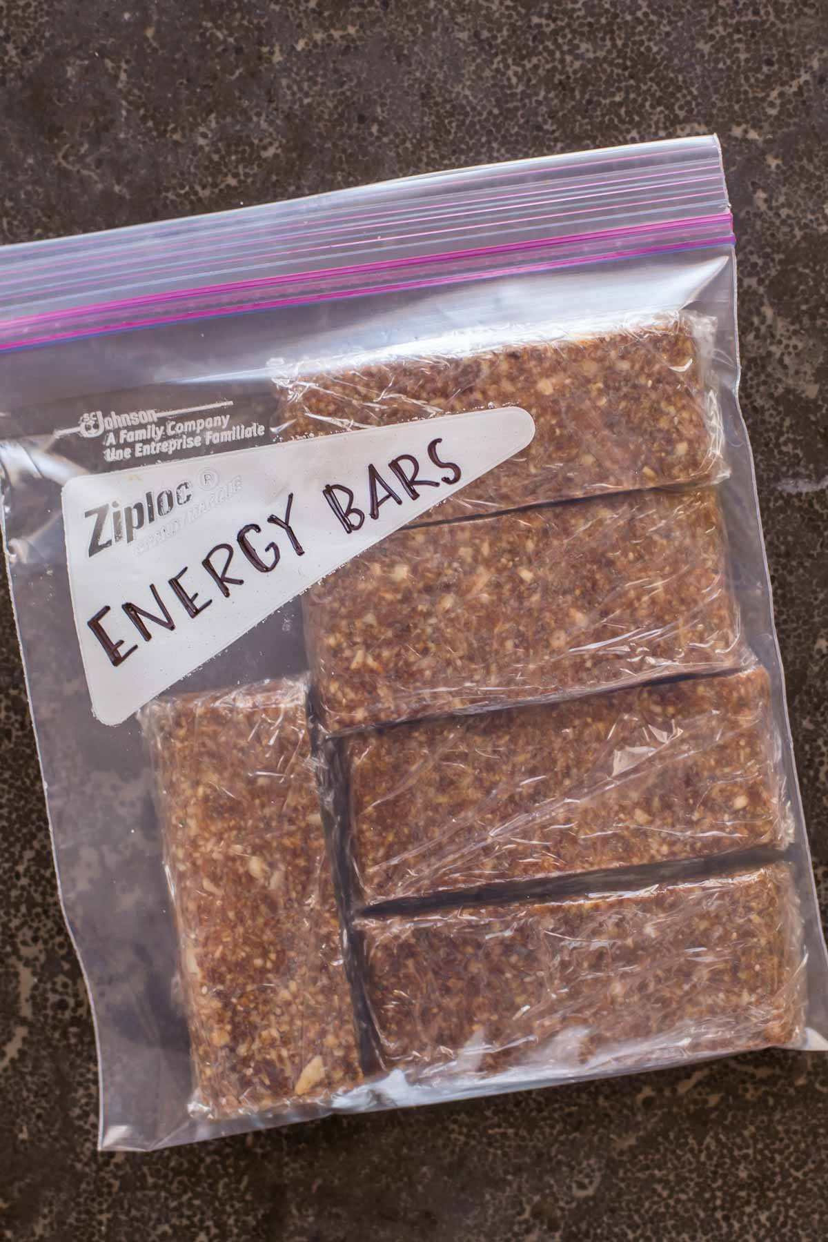 Five Ingredient No Bake Energy Bars individually wrapped in plastic, inside a Ziploc bag labeled Energy Bars.