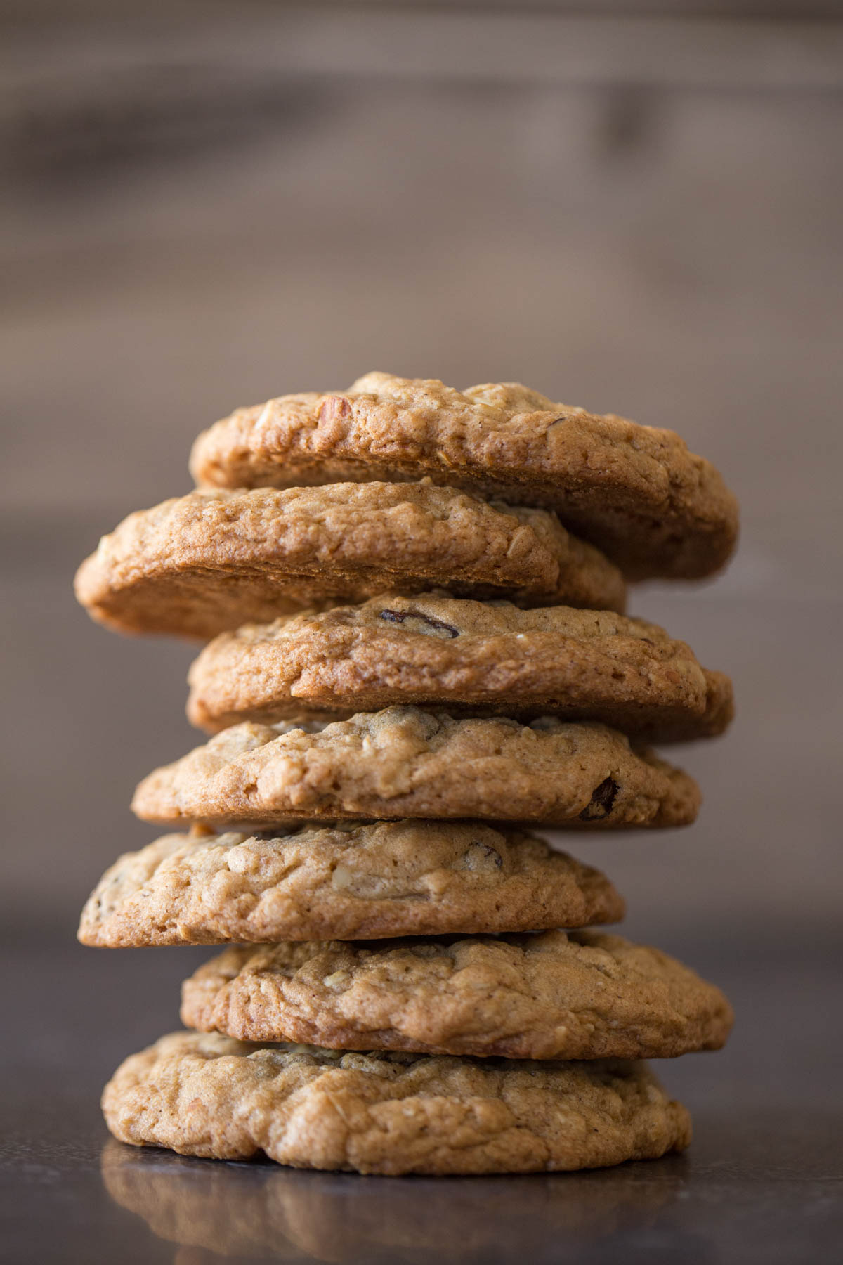 Seven Bakery Style Oatmeal Raisin Cookies stacked on top of each other.