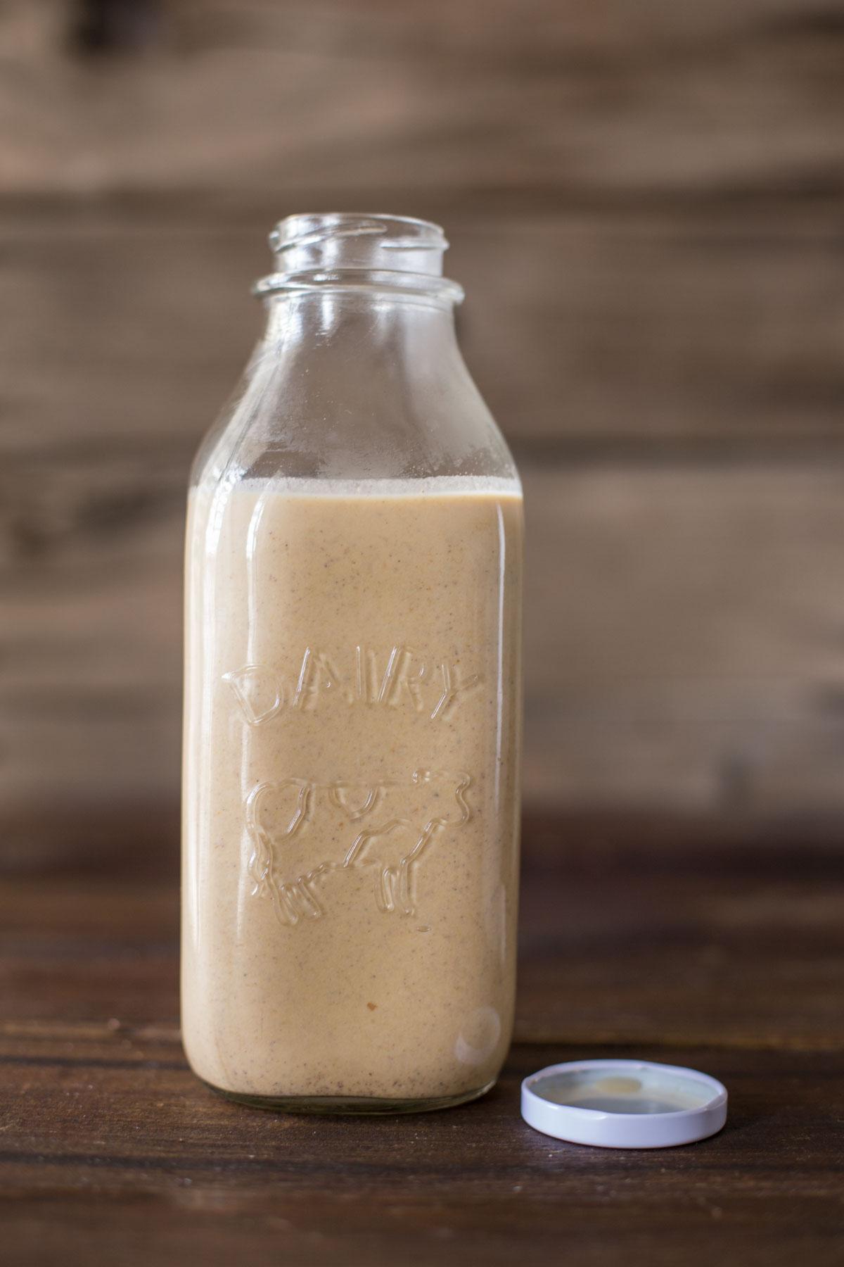 Homemade Pumpkin Spice Coffee Creamer in a glass jar.
