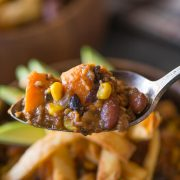 A hearty sweet potato chili with black beans, sausage and corn that'll fill you up and keep you going all winter long. Just the right amount of sweet and spicy!