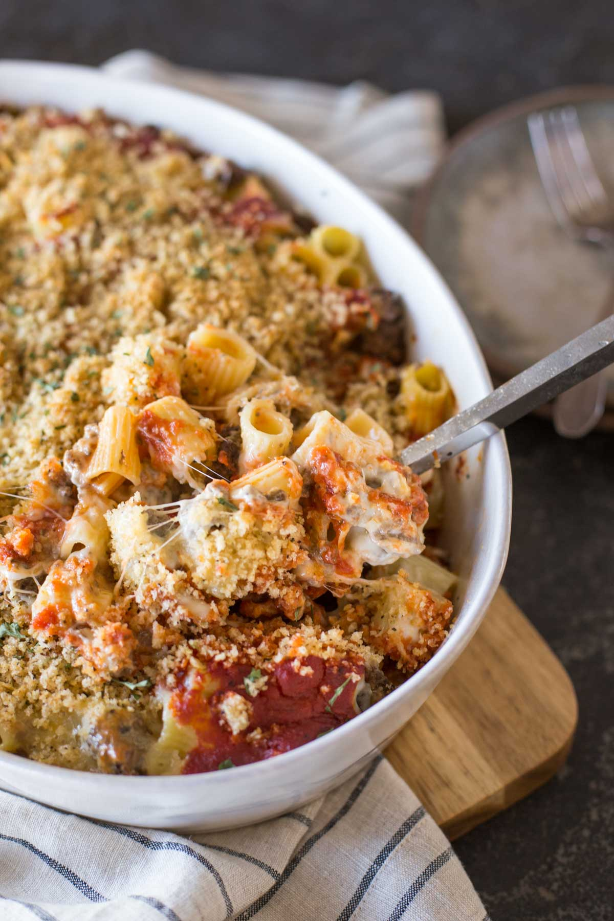 Cheesy Tomato Alfredo Pasta Bake in a baking dish.