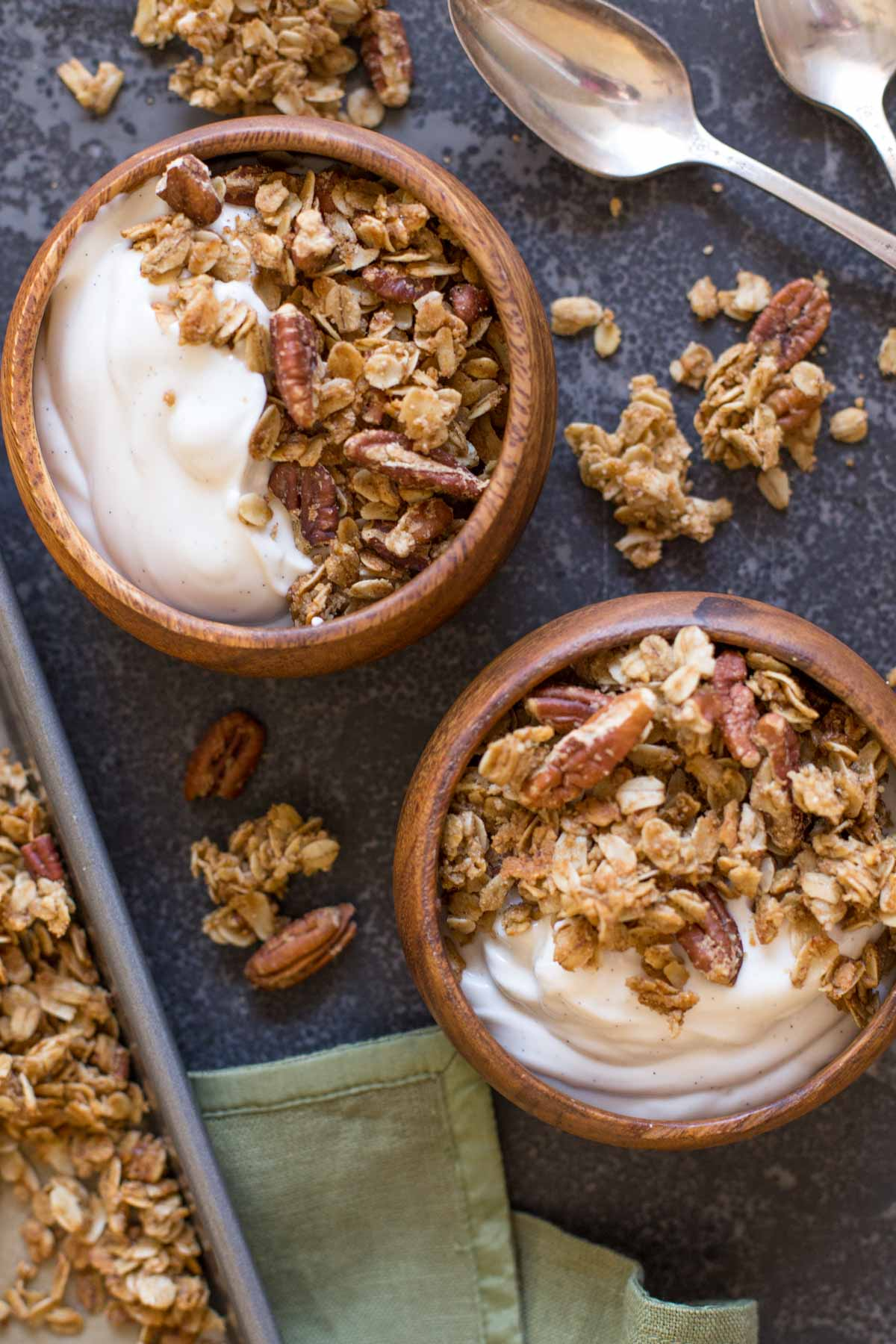 Two bowls of yogurt and Gingerbread Spice Granola.
