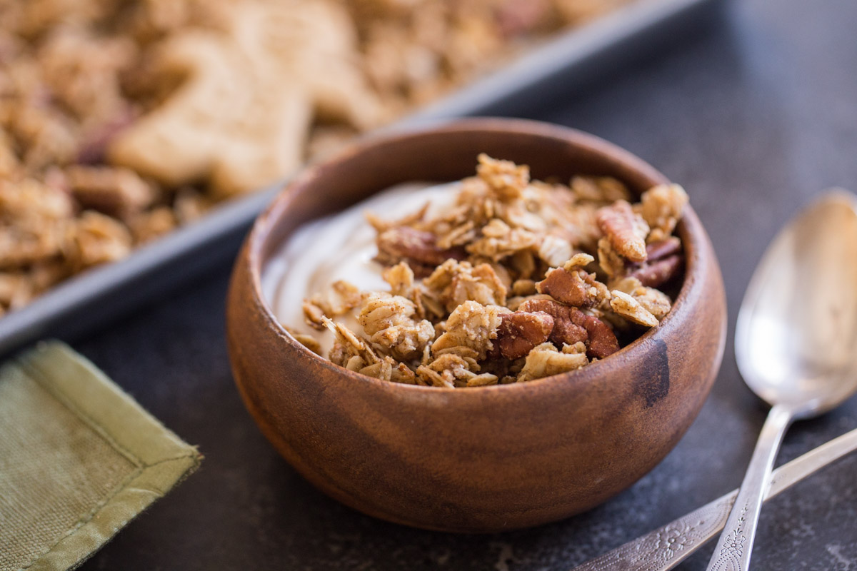 A bowl of yogurt and Gingerbread Spice Granola.