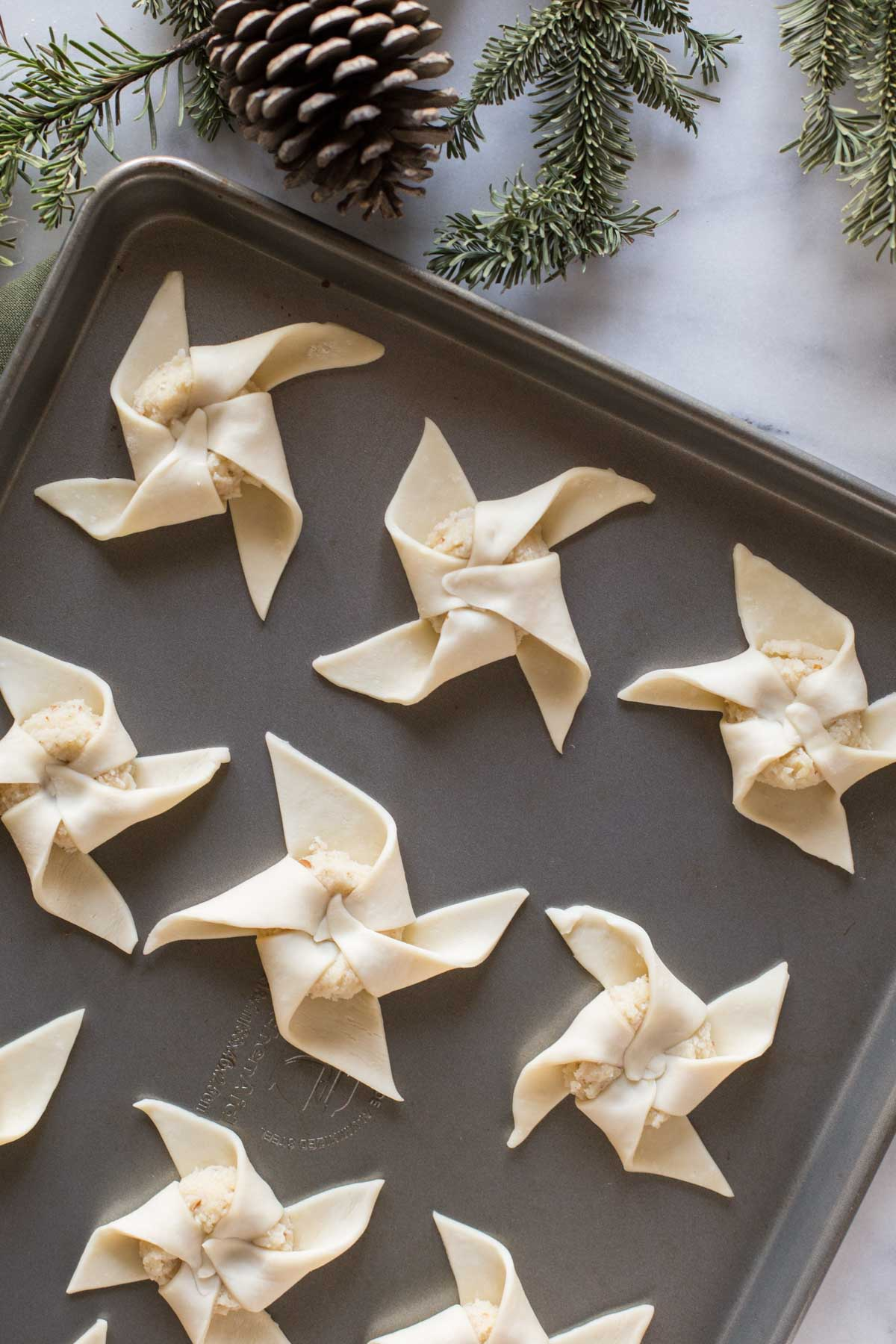 Make Ahead Almond Pinwheels on a baking sheet before being baked.