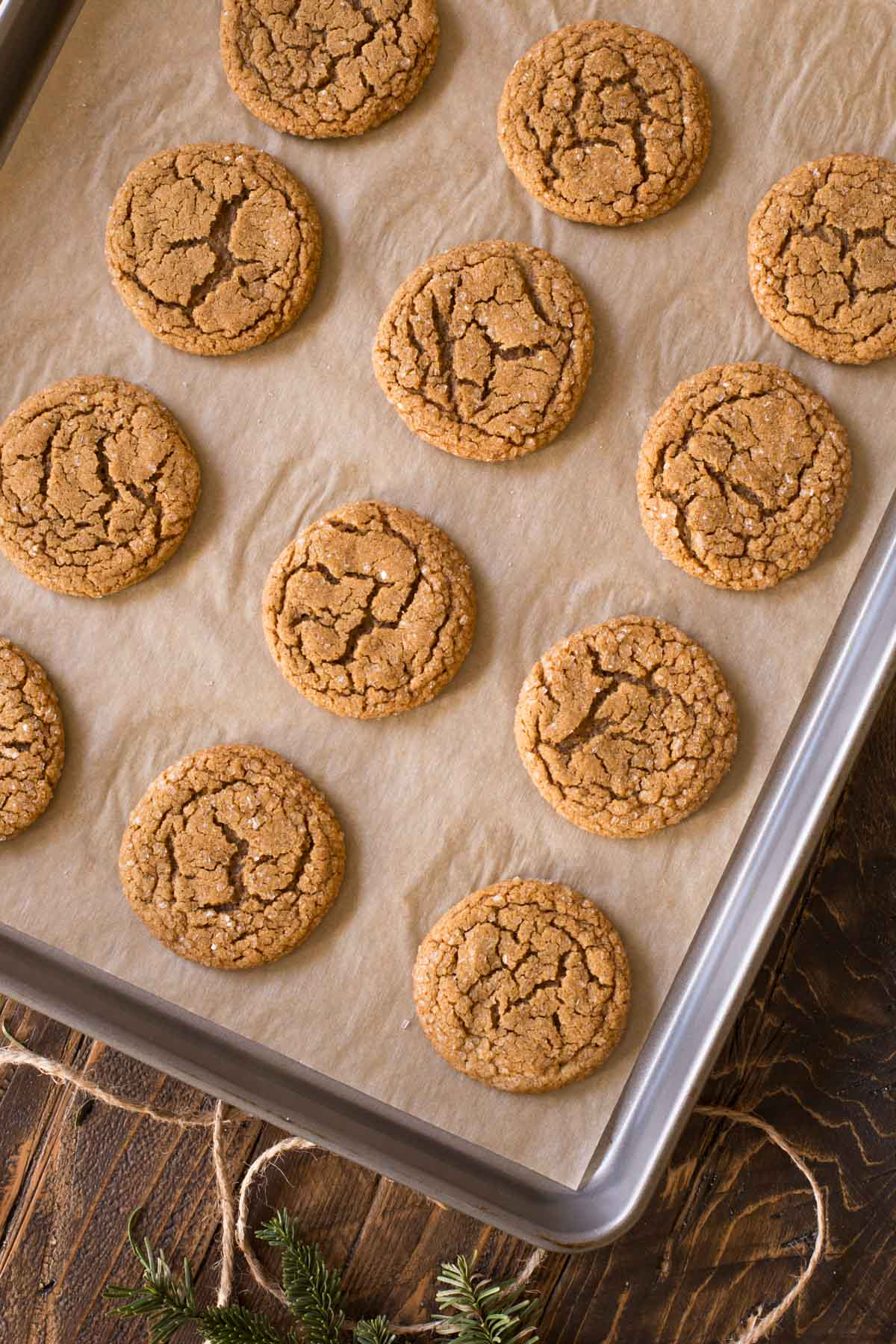 Old Fashioned Ginger Snaps on a parchment paper lined baking sheet.