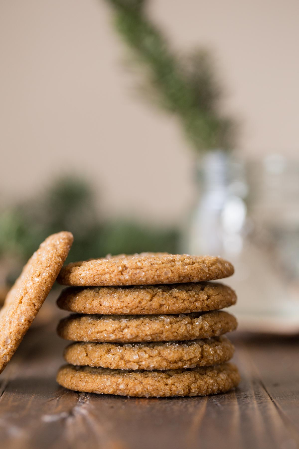 Five Old Fashioned Ginger Snaps stacked on top of each other, with one Old Fashioned Ginger Snap leaning against the stack.