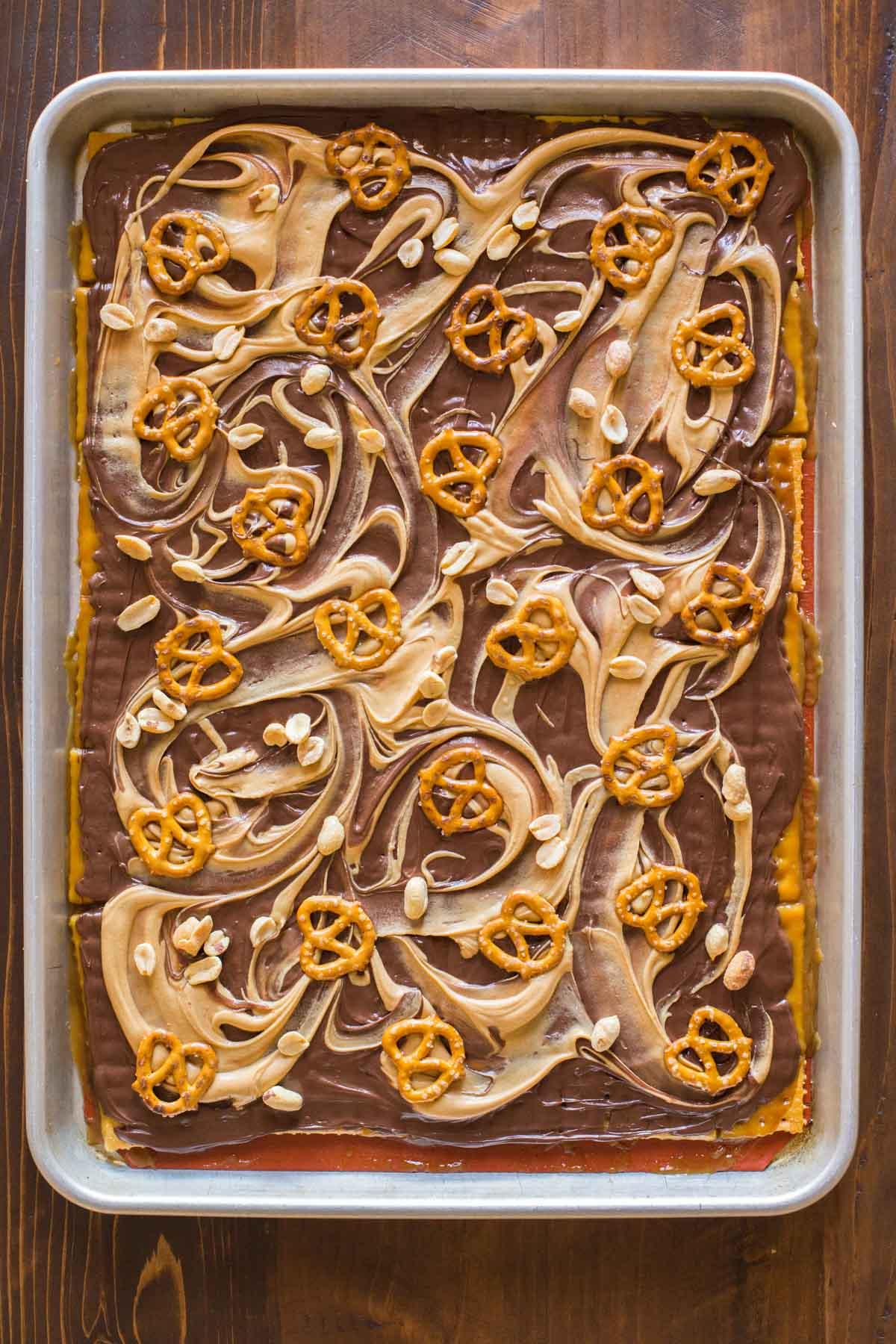 Take Five Cracker Bark on a Silpat lined, rimmed baking sheet.