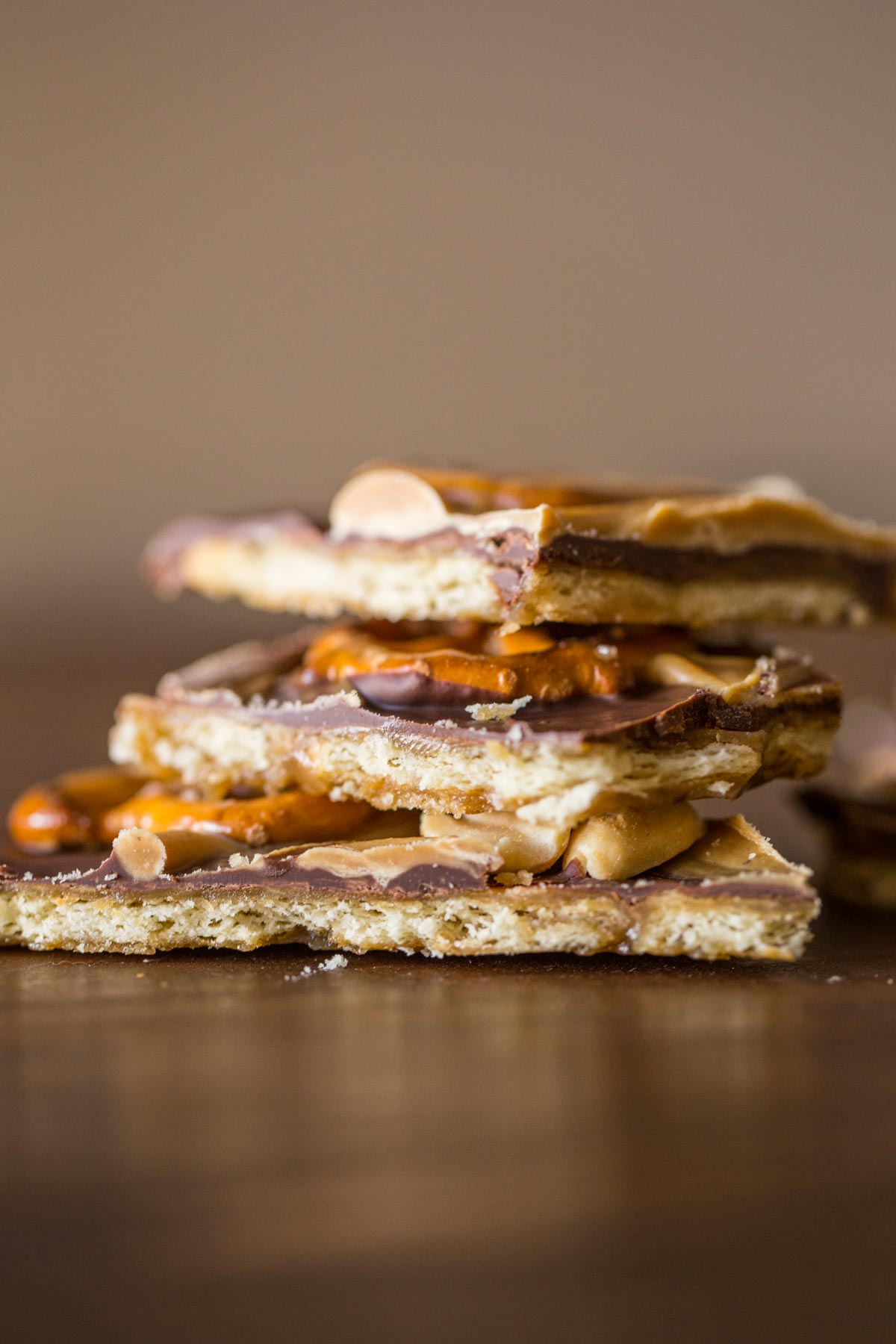 Take Five Cracker Bark pieces stacked on top of each other.