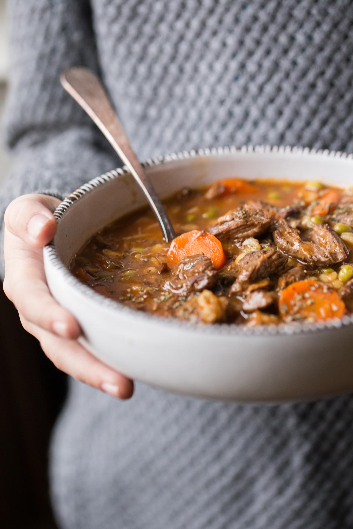 Beef and Barley Vegetable Soup in a bowl with a spoon.
