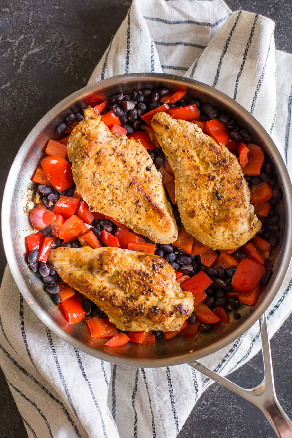 A skillet with all the ingredients for the Healthy Southwestern Chicken Bowls.