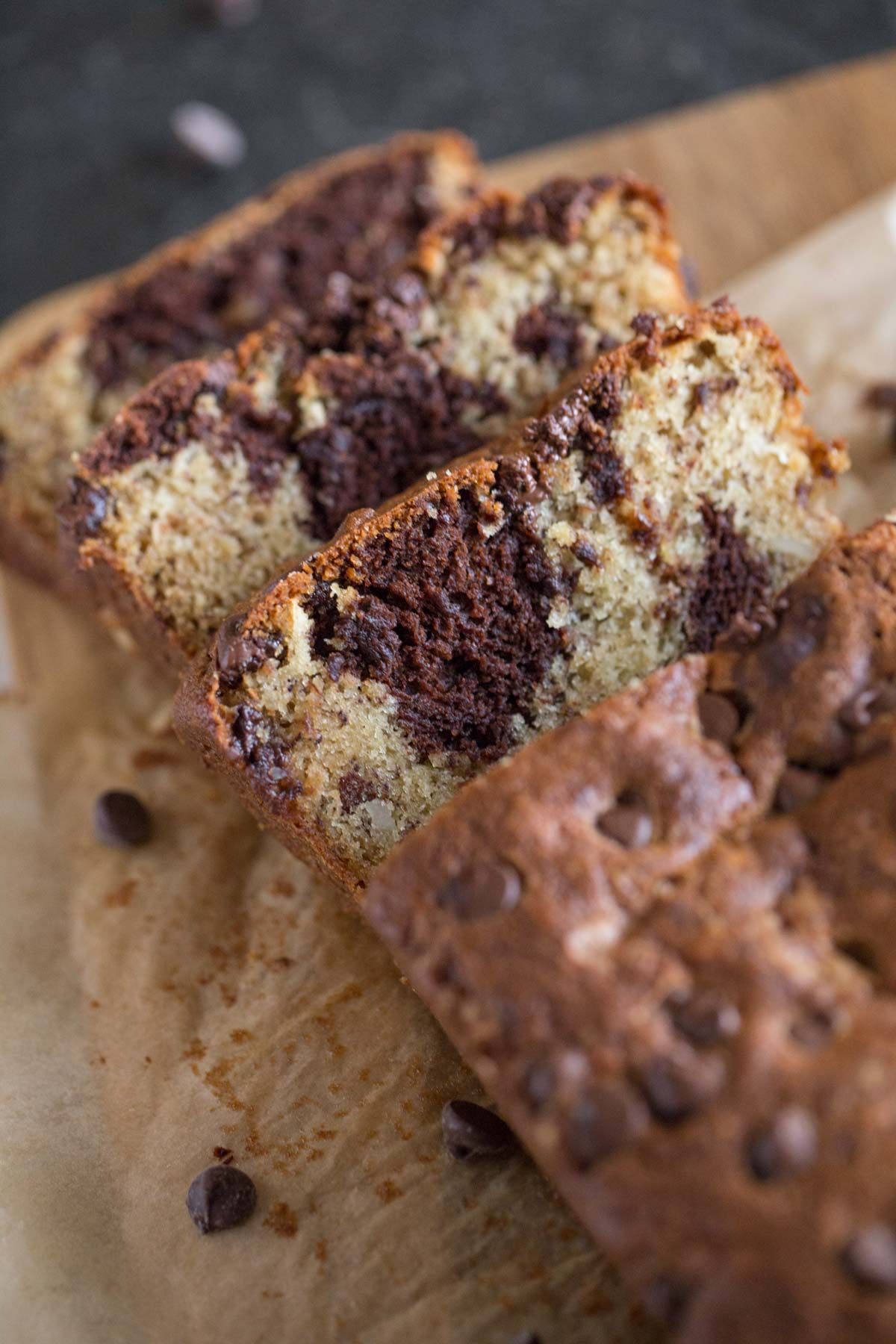 A loaf of Marbled Chocolate Banana Bread that has been sliced.