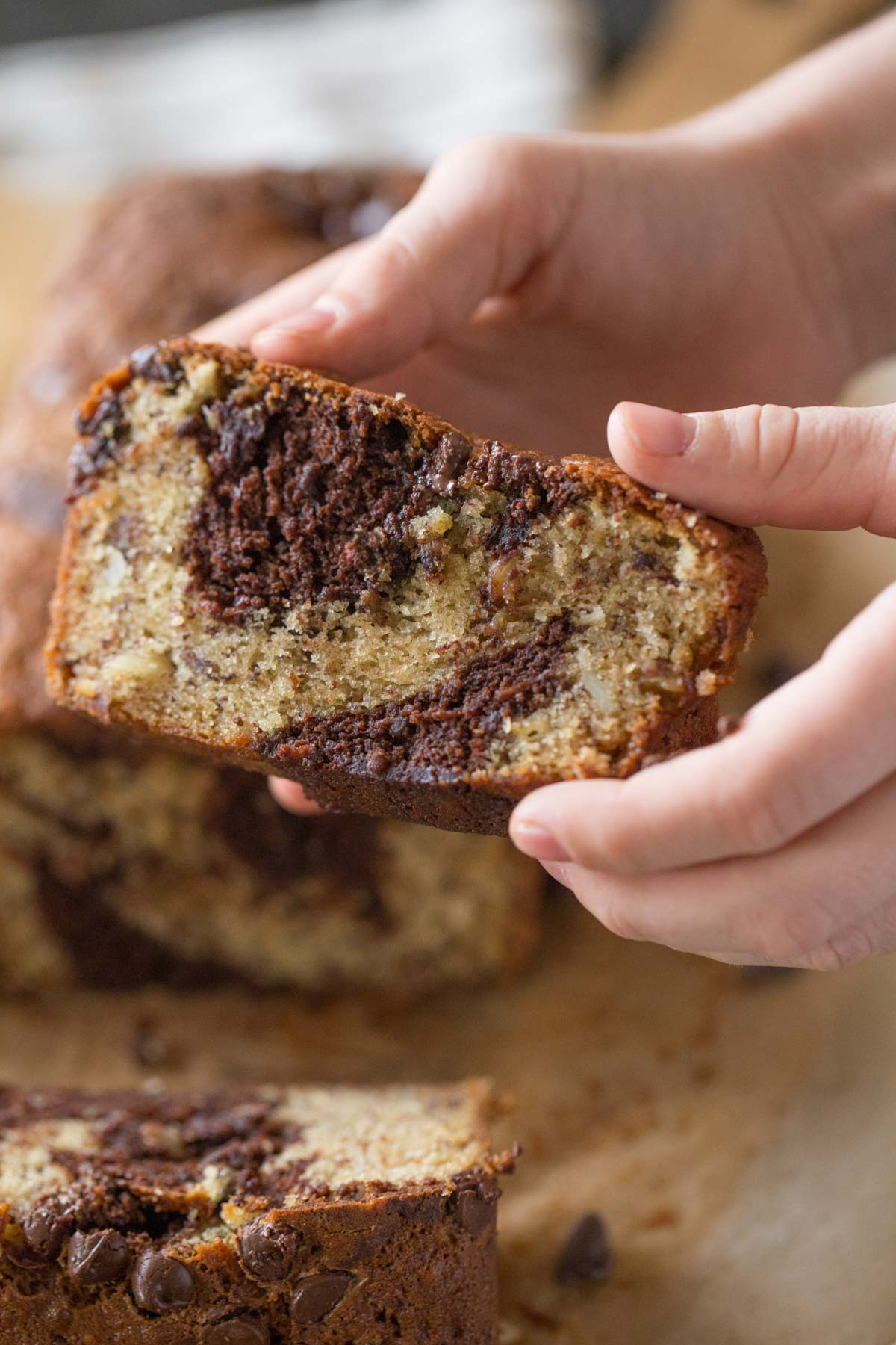A slice of Marbled Chocolate Banana Bread.