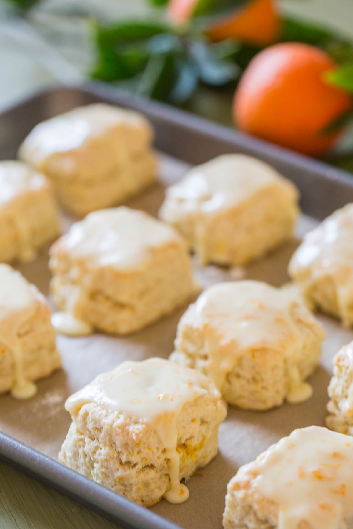 Mini Orange Cream Scones on a parchment paper lined baking sheet.