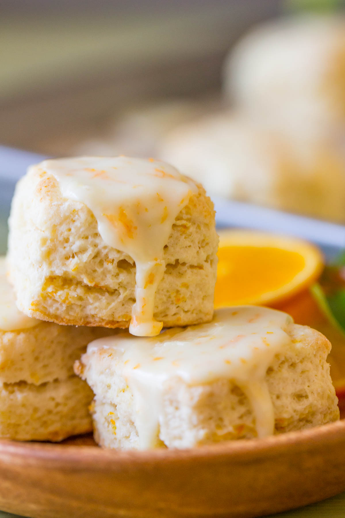Mini Orange Cream Scones staked on a small wood plate.
