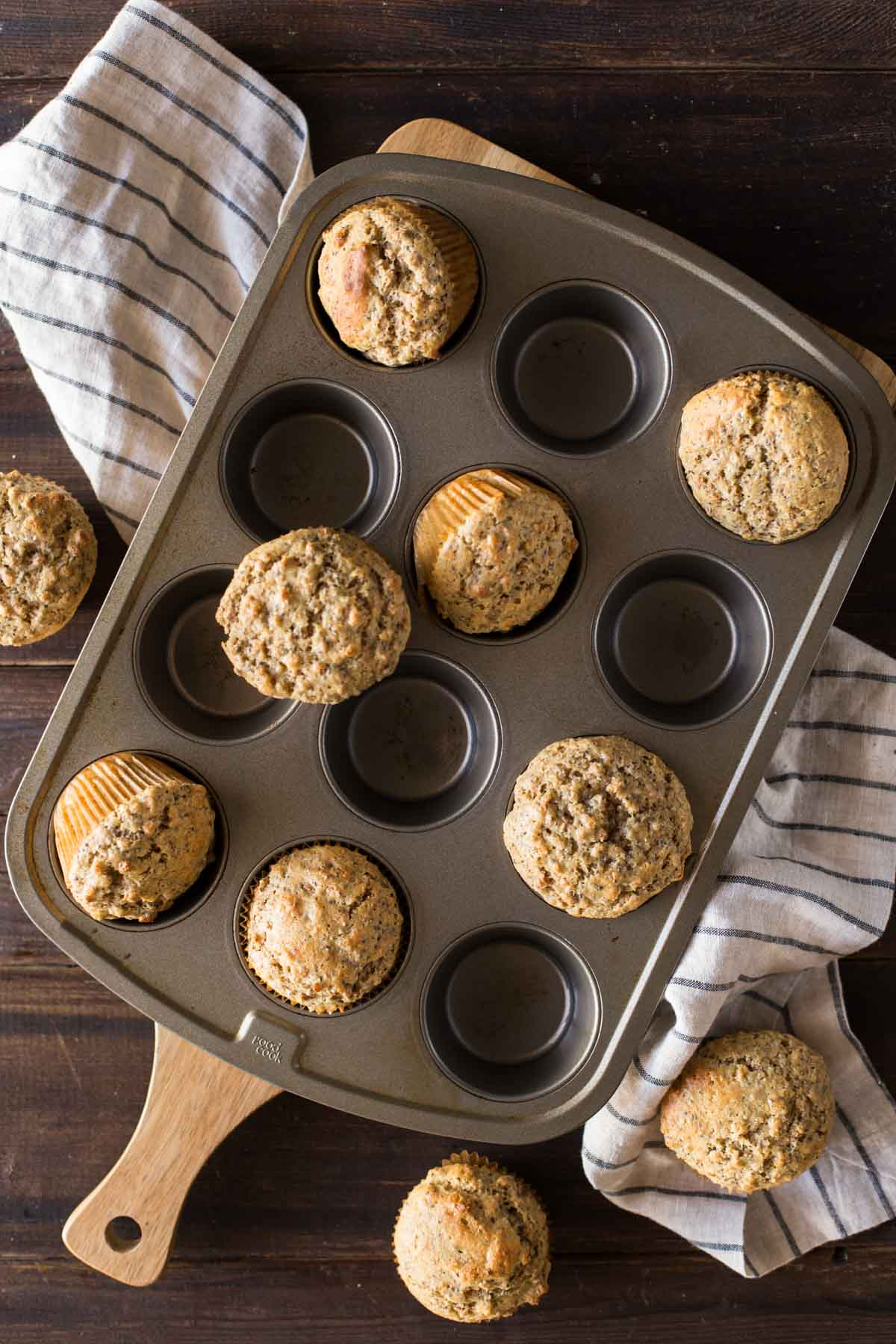 Honey Bran Muffins in, on and around a muffin pan.