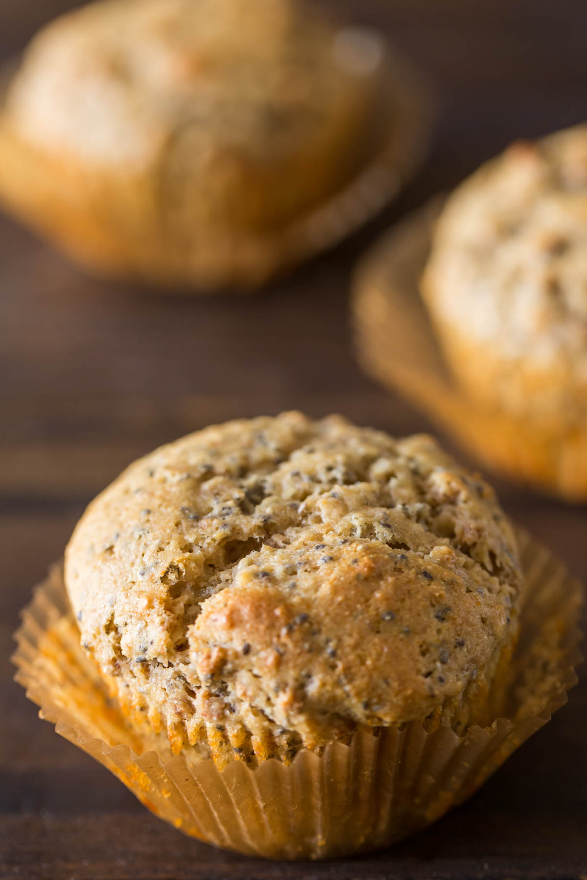 A Honey Bran Muffin with two muffins in the background.