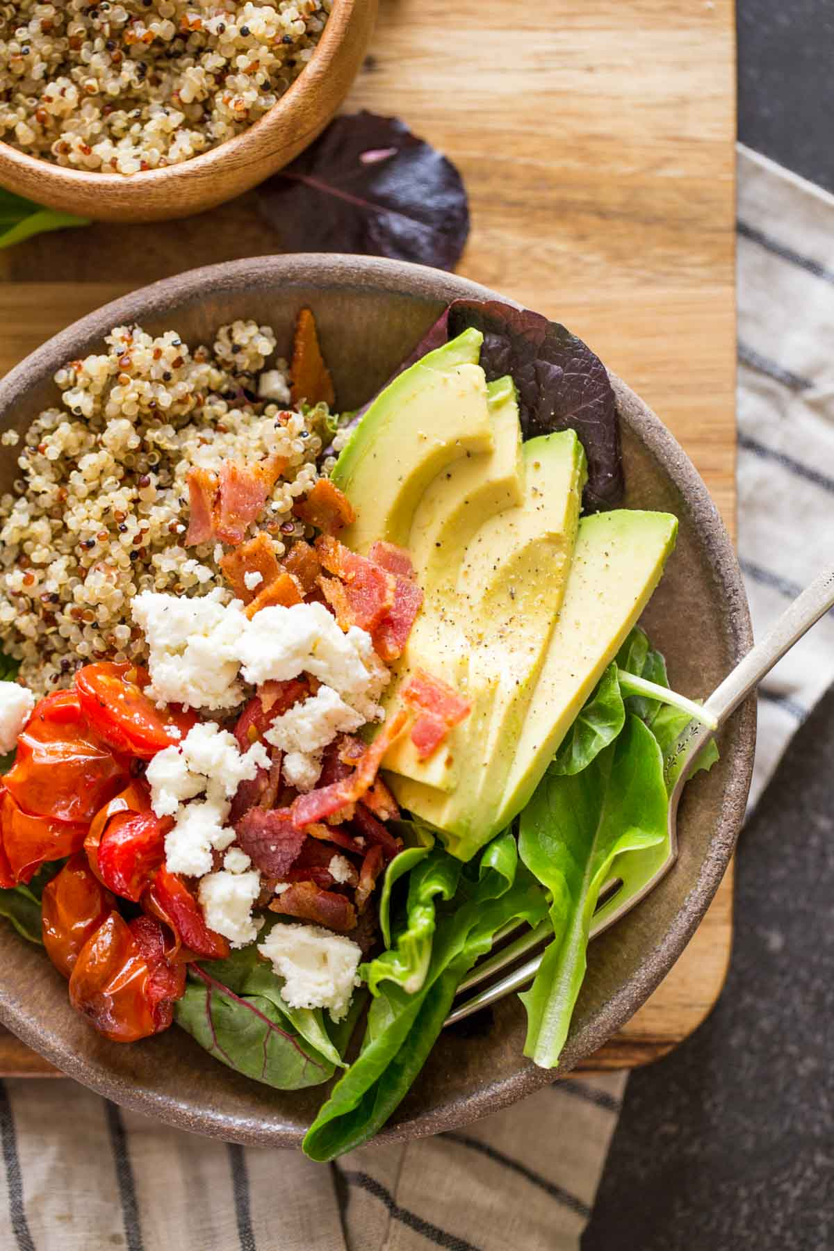 A BLT Bliss Bowl and a small bowl of quinoa.