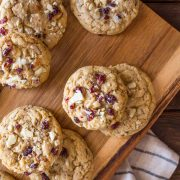 I ADORE these Cranberry Almond White Chocolate Chunk Cookies! They bake up thick and chewy, with a rich, sweet buttery flavor studded with tangy bits of cranberry!
