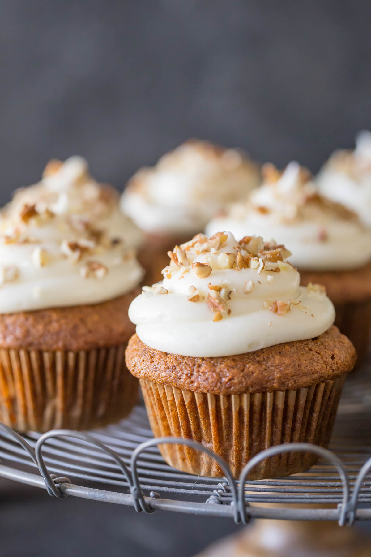 Carrot Cake Cupcakes on a cake stand.