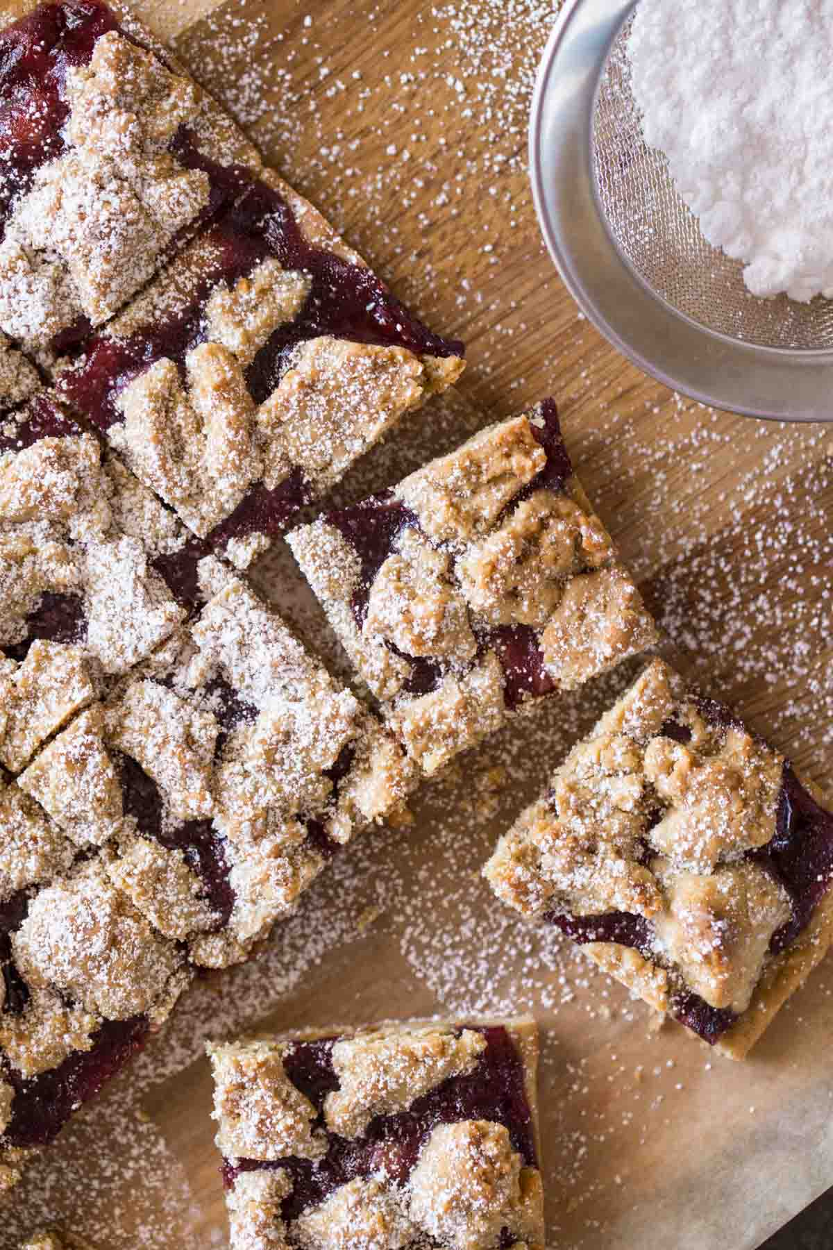Peanut Butter and Jelly Oat Bars cut into squares and dusted with powdered sugar.