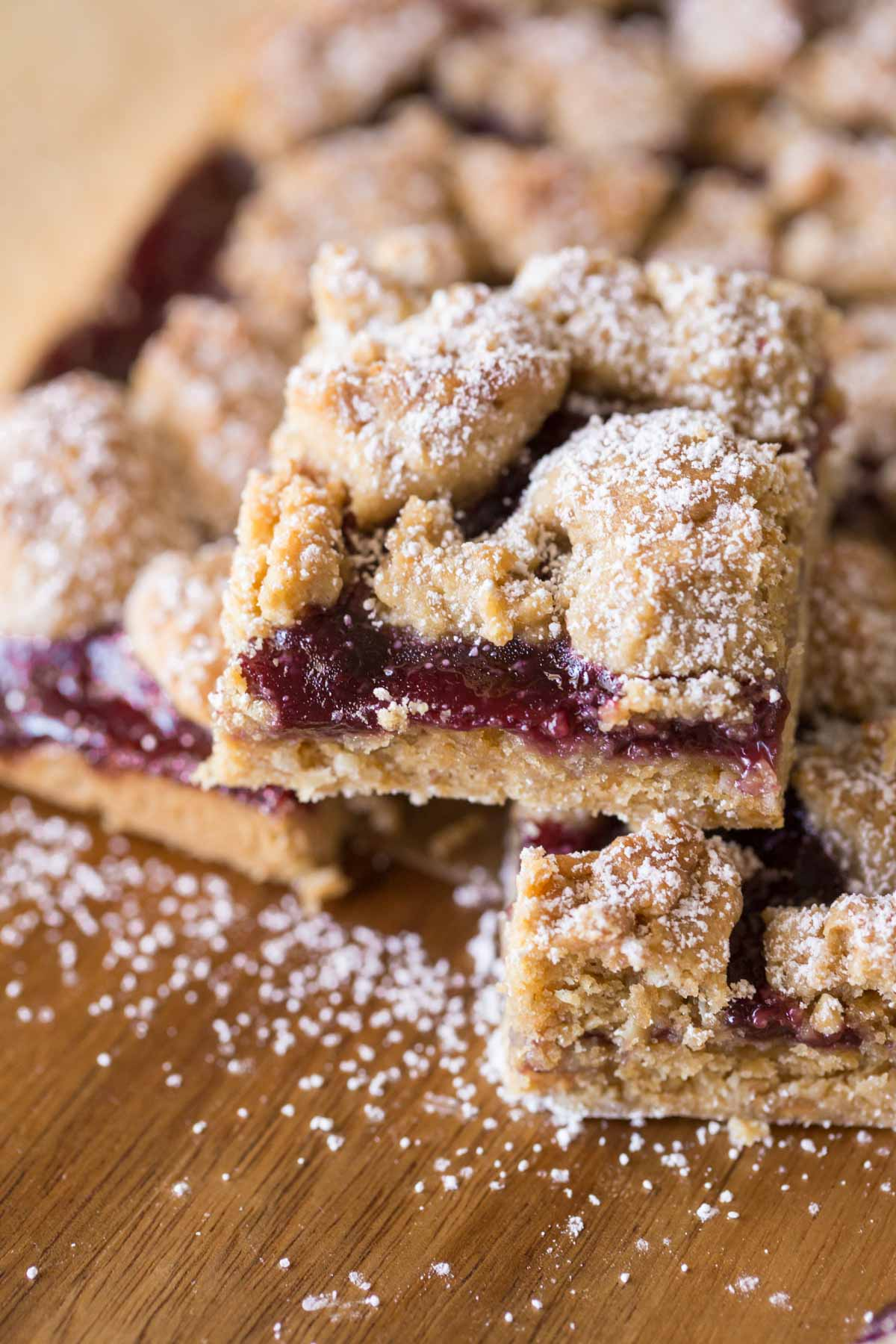 Peanut Butter and Jelly Oat Bars dusted with powdered sugar.