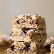 These Peanut Butter and Jelly Oat Bars have a soft peanut butter cookie base, mixed berry preserves, and more crumbled peanut butter cookie dough!