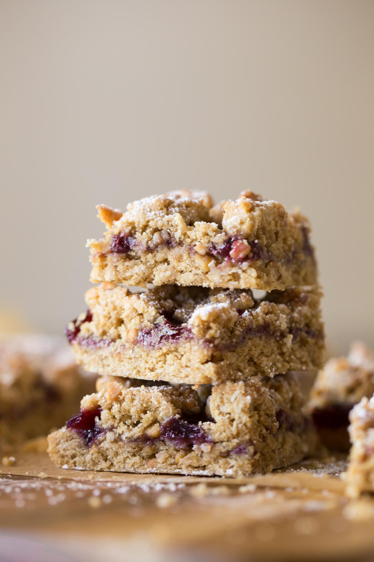 Three Peanut Butter and Jelly Oat Bars stacked on top of each other.