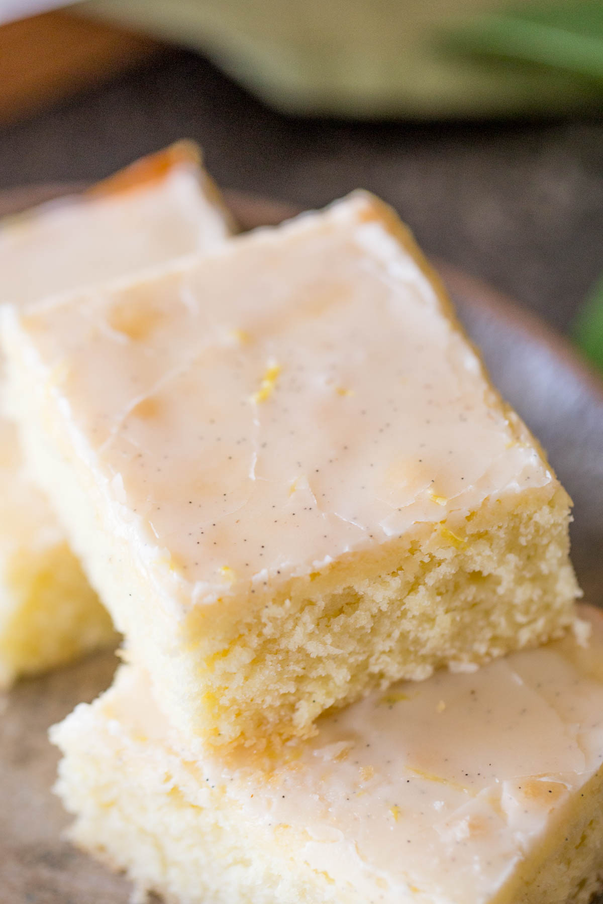 Three Vanilla Bean Lemon Bars on a plate.